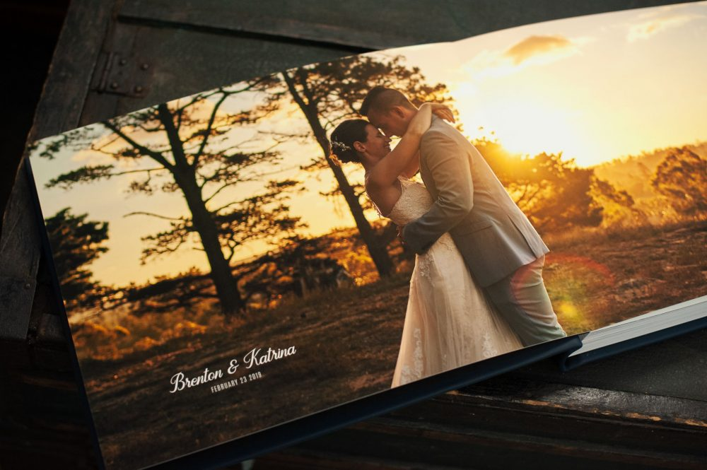 Uninterruped bridal landscape sunset portrait photos across the full double page spread